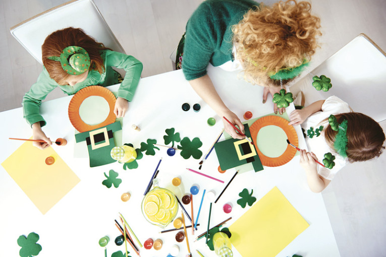 Family preparing decorations for Saint Patrick's Day